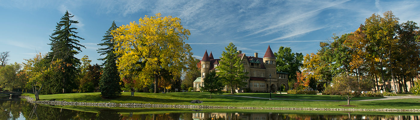 View of Brookside Mansion across the lake during fall.
