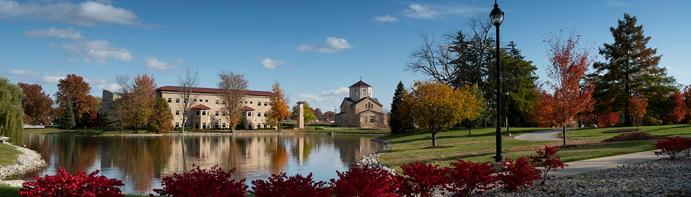 View across the lake looking at JPII and the chapel buildings outside.